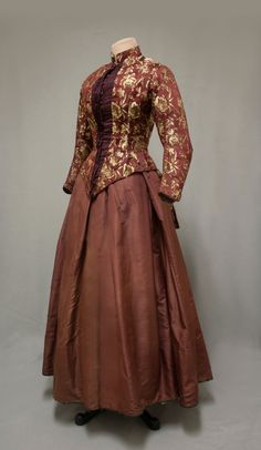 """Dress: 1880, brocade, silk taffeta.From the """"Women of New England: Dress from the Industrial Age, 1850–1900"""" Exhibit, January 17-March 11, 2011 (William Benton Museum of Art - Press Images)"""