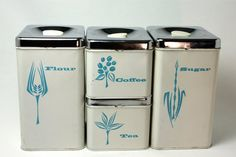Lincoln BeautyWare coffee tea flour & sugar canisters with the turquoise flower... and something I would love to own!