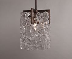 Vasa Pendent in solid bronze. Consists of four panels of cast glass that is then cut and polished on all edges.