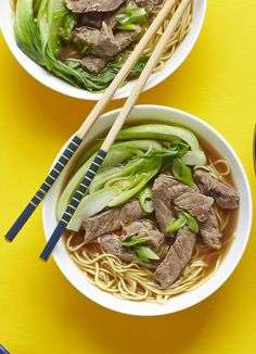 The best recipe for an easy beef noodle soup. Cook steak strips in stock with spring onion and ginger before pouring over hot noodles. Quick bowl food for two.