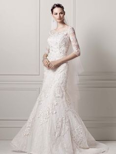 Be queen for the day (or at least feel like one) in this romantic, lace trumpet gown, featuring 3/4 sleeves, an ultra-feminine illusion neckline, and layered beaded lace appliques. Click to learn more and find a David's Bridal store near you.