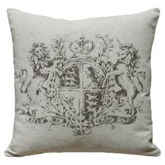 Linen pillow with a hand-screened crest motif.    Product: PillowConstruction Material: 100% LinenColor: ...