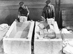Workers unload cases of liquor from marble blocks, which were used to conceal alcohol, on a pier following the repeal of Prohibition, Brooklyn, New York City.