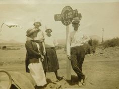 Three women and one man standing around a road sign in 1920's Silver City, NM.  #silvercity #silvercitynm #silvercitynewmexico #newmexico #oldnewmexico