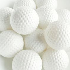 Golf balls...does anyone know why they have all those dimples?