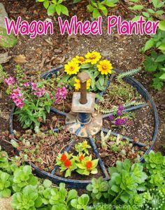 Wagon Wheel Planter   Turn An Old Wagon Wheel Into A Fun Planter For The  Flower
