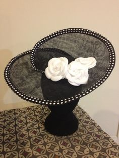 Black sinamay Hatinator with polka dot trim and 3 camelias - Susie Richards #millinery #HatAcademy