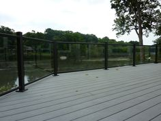Ornamental aluminum railing with glass on composite deck overlooking river