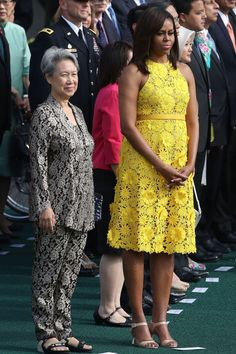 FLOTUS wears a summery floral appliqué dress by Naeem Khan with green pendant earrings and nude heeled sandals for a visit to the National Gallery of Art with the Prime Minister of Singapore, Lee Hsien Loong, and his wife, Ho Ching.