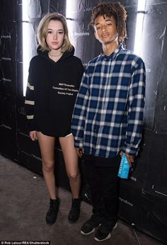 His favourite model: The actor's girlfriend wore a hoodie from his clothing line, along wi...