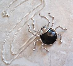 Silver Spider Necklace Large Black Faceted Acrylic Silver Tone 18 Inch Curb Chain Vintage V0421 by cutterstone on Etsy #spidernecklace #silverspider #blackspider #vintagejewelry #Halloween
