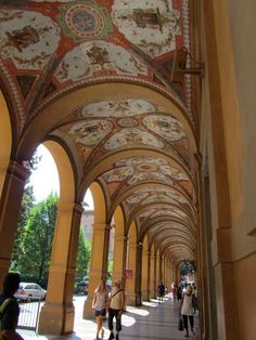 What I like best about this photo is the regular people walking under the arches. Bologna - I Portici di piazza Cavour