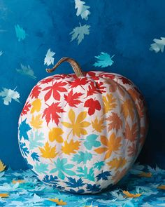 To make these festive pumpkins, we cut out leaves using our templates and layers of colorful tissue. When punching leaf shapes from tissue paper, add a sheet of plain paper to the top of the stack to keep the tissue from ripping.