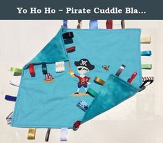 Yo Ho Ho ~ Pirate Cuddle Blanket with Ribbon Tabs. Vibrant Modern PIRATE themed toddler blanket that reverses to Blue fleece Fabric. Ribbon Accent tags along edges. Ribbon Tabs provide comfort, play, security and toy for baby and child. Double stitched for security. A great therapy toy for special needs and Austistic children. 17 X 21 INCHES A great baby shower gift. New Baby Gift. Baby's first and favorite security blanket.
