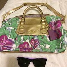 Coach shoulder bag Very colorful Coach bag with gold strap, and lavender interior with some wear. *No trades* authenticity guaranteed :) Coach Bags Shoulder Bags