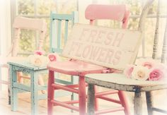 use all those old chairs in the garage....paint them bright colors for the yard...I also like the sign.
