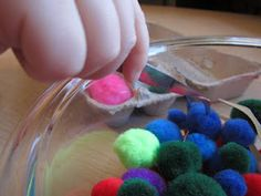 """""""The Pom Pom Game""""  A great game for concentration and hand-eye coordination"""