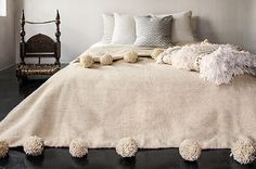 Handmade Moroccan Berber Wool Blankets with Pom poms on both ends .  Color : Ivory cream The wool is the softest Quality of berber sheep wool from