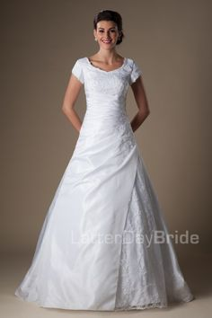 The Glenwood   This A-line silhouette gown has a sweetheart neckline with beaded applique overlay on the bodice and skirt with a beautiful and slimming wrap style waist.    Recommended Petticoat: A-line 2    Gown available in Ivory or White.    *Gown pictured in White.     Available at LatterDayBride.com or in Store Located in Salt Lake City, Utah