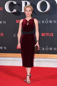 Gillian Anderson wearing MINNY and carrying LOCKETT MINAUDIERE to the 'The Crown' TV premiere in London.