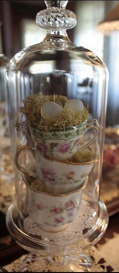 Teacups stacked in a narrow cloches or tall glass jars make lovely easter or tea party decoration. Oster Dekor, Cloche Decor, The Bell Jar, Bell Jars, Deco Floral, Rose Cottage, Decoration Table, Tea Party Decorations, Bird Decorations