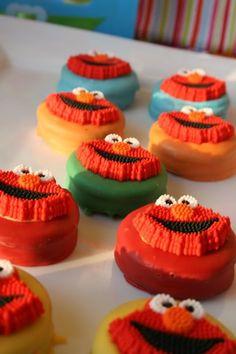 I love these dipped oreos    http://karaspartyideas.com/2011/03/sesame-street-elmo-birthday-party.html#