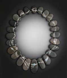 Mizu Necklace: Mizu is the Japanese word for water. A gentle current flows around this necklace, made of beach stones inlaid with reclaimed sterling, and hand pulled venetian glass | Contemporary Jewelry Design by Andrea Williams