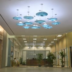 Glass lighting pieces evoke feelings of wonder and leave lasting impressions. Visit www.wgwcustom.com to learn more! Commercial Office Space, Office Space Design, Glass Lights, Ceiling Lights, Art And Architecture, Chandelier, Blown Glass, Lighting, Design Ideas
