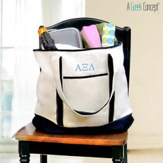 """Alpha Xi Delta Weekender Tote from A Greek Concept.  Get 10% off your purchase with DISCOUNT CODE """"AXD10""""!"""