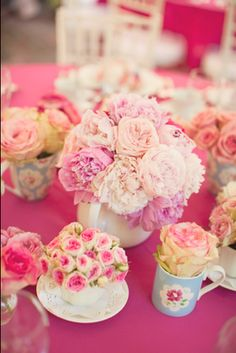 beautiful flowers in teacups and pots for a tea party