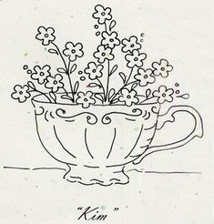 forget me nots in a tea cup embroidery pattern