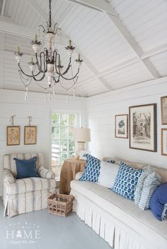 Blue and white cottage living room via True Blue Cottage - Holly Mathis Interiors