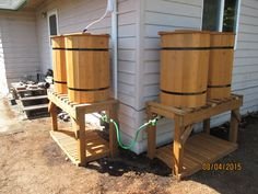 Our latest quad rain barrel system. Two double barrel systems connected together through the ball valve spigots on 3 ft. Barrels on right connected to a downspout via the Garden Water Saver diverter. This was installed in Hillsboro, Oregon. Water Collection System, Rain Collection, Backyard Projects, Outdoor Projects, Garden Projects, Rain Barrel System, Rain Barrel Stand Diy, Water Catchment, Water Barrel