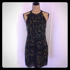 """Black Floral Dress Super cute black dress with floral design. Ruffles in front. Back buttons around neck. Zips up side. Size 4. Layered trim at bottom 95% polyester 5% spandex. Dress length is apprx 36.5"""" long bust is apprx 36"""" Ice Dresses Midi"""