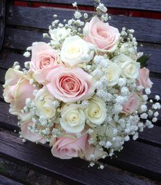 Simplistic elegance of akito and sweet avalanche roses nestled in gypsophilia. www.am-flowers.co.uk