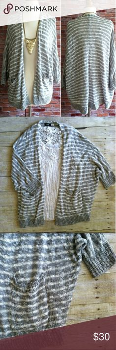 """Urban Outfitters Slouchy Open Cardigan Super soft comfy by BDG features gray and white blend stripes,  2 front pockets, and short dolman sleeves. 57% Cotton 43% Acrylic  27"""" long in perfect condition Urban Outfitters Sweaters Cardigans"""