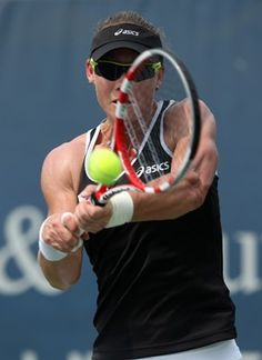 Samantha Stosur of Australia hits a backhand against Ekaterina Makarova of Russia during day six of the Western Southern Open at Lindner Family Tennis Center on August 2012 in Mason, Ohio. Ekaterina Makarova, Tennis Australia, Mason Ohio, Emirates Airline, Tennis Center, Sports Photos, Winter Olympics, Winter Sports, Tennis Racket