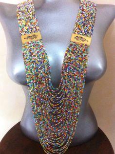 """Collar en mostacilla estilo: """"lluvia de colores"""" con hebillas en baño de oro Peyote"""
