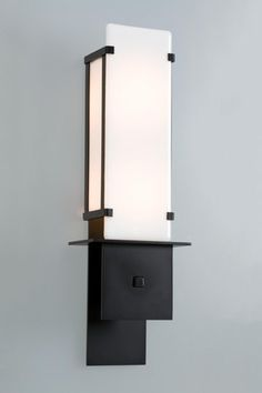 Contemporary light fixture with a striking combination of custom white glass and black finish on this wall mount indoor sconce by Hammerton. Shown here, Contemporary Covered Sconce in Matte Black finish with custom white glass Sconces, Contemporary Sconces, Contemporary Decor, Wall Lamp, Contemporary Vs Modern, Contemporary Lighting, White Glass, Contemporary Light Fixtures, Light