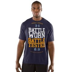 Mens UA Football Graphic T-Shirt Tops by Under Armour Extra Large Midnight Navy by Under Armour. $24.99. Lightweight cotton blend delivers ultra-soft comfort and superior performance. Signature Moisture Transport System wicks sweat away from the body, keeping you cool, dry, and focused. Anti-odor technology prevents the growth of odor causing microbes, keeping your gear fresher, longer. Durable ribbed collar provides a comfort fit. Cotton/Polyester. Imported.