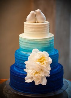 Blue ombre wedding cake, by Barr Mansion and Artisan Ballroom.  // Matt Montalvo Photography  with our contemporary love birds wedding cake top (http://www.weddingfavorsunlimited.com/love_birds_contemporary_cake_topper.html)