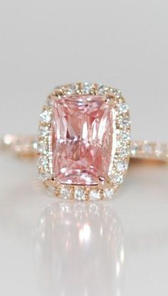 Rose gold ring engagement ring. Peach sapphire 1.63ct cushion sapphire diamond ring.