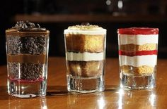 This year, I'm buying plastic shot glasses from Gordon's and making a variety of mini desserts. It's easy - bake up your favorite pies and cakes, then deconstruct and create smaller versions. Everyone can then get a little of each dessert. Mini Desserts, Shot Glass Desserts, Small Desserts, No Bake Desserts, Just Desserts, Delicious Desserts, Dessert Recipes, Individual Desserts, Wedding Desserts
