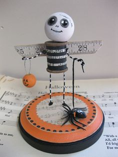 Cute idea....I could make this.  Tape measure, ping pong ball, music, spool of thread...etc.  Looks easy.