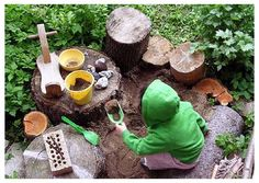 Cozy sand pit enclosed by logs and big rocks