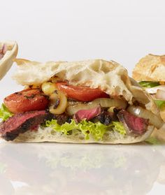 Grilled Steak Sandwich with Blackened Onions Recipe    Active Time: 20 minutes  Total Time: 20 minutes  Recipe Ingredients    4 plum tomatoes, halved lengthwise  3 Tbsp olive oil Kosher salt and pepper  1 lb London broil, sirloin or strip steak  2 mediu...