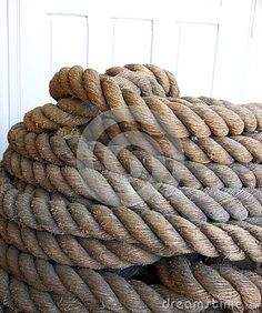 Photo about This is a closeup of a coil of old natural fiber twisted three strand mooring line for a large ship. Image of pile, fiber, rope - 74028070 Merino Wool Blanket, Boats, Fiber, Ships, Stock Photos, Natural, Image, Low Fiber Foods, Nature