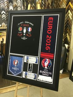 What do you get when a customer brings you a bag full of items to frame? An awesome frame to perfectly display your memories! This was a little more complicated as we had to build a box for the trophy inside the box but the end result is awesome! #customframing #euro2016 #trophy #shadowbox #mtlmoments   For more information please visit www.eraframes.com