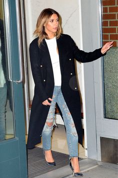 21-11-2013 | #lookoftheday Kim Kardashian wearing a chic long black overcoat, pointed heels paired with ripped boyfriend jeans