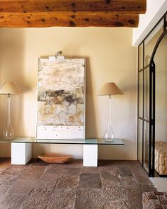 Chic mix of art, textured natural materials and modern elements.